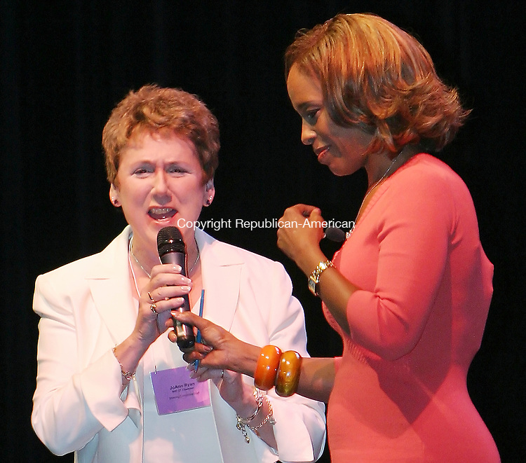 TORRINGTON, CT. 30  September  2005-093005SV02--From left, JoAnn Ryan, President of the Northwest Connecticut Chamber of Commerce, stands with Gayle King, editor-at-large for O The Oprah Magazine, and keynote speaker of the chamber&rsquo;s First Women of the World Forum at the Warner theater in Torrington Friday.<br /> (JoAnn Ryan, Gayle King, (cq))