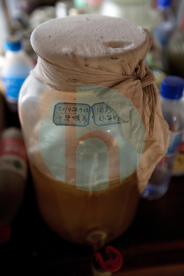 April 27th 2011_Anlong Village, Sichuan, China_ A fermented concoction sits at the ready on an organic farm, which is located near the city of Chengdu, in the village of Anlong in Sichuan, China.  Photographer: Daniel J. Groshong/The Hummingfish Foundation
