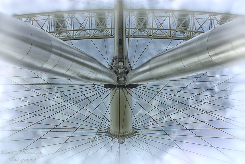 Looking straight up into the structure and hub of the wheel forming the London Eye.