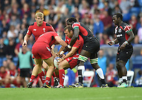 Wales's Gareth Davies looks to pass the ball to a team-mate<br /> <br /> Kenya Vs Wales - men's placing 5-8 match<br /> <br /> Photographer Chris Vaughan/CameraSport<br /> <br /> 20th Commonwealth Games - Day 4 - Sunday 27th July 2014 - Rugby Sevens - Ibrox Stadium - Glasgow - UK<br /> <br /> © CameraSport - 43 Linden Ave. Countesthorpe. Leicester. England. LE8 5PG - Tel: +44 (0) 116 277 4147 - admin@camerasport.com - www.camerasport.com
