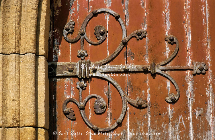 Detail of an old door belonging to the Le Puy Cathedral, Le Puy-en-Velay, Auvergne, France.