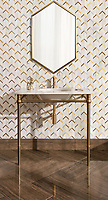 Belen, a hand-cut stone mosaic, shown in polished Calacatta and brushed brass. Marble washstand slab in Calacatta Gold. Bayard 12x24 large format field tiles, set into a herringbone pattern.