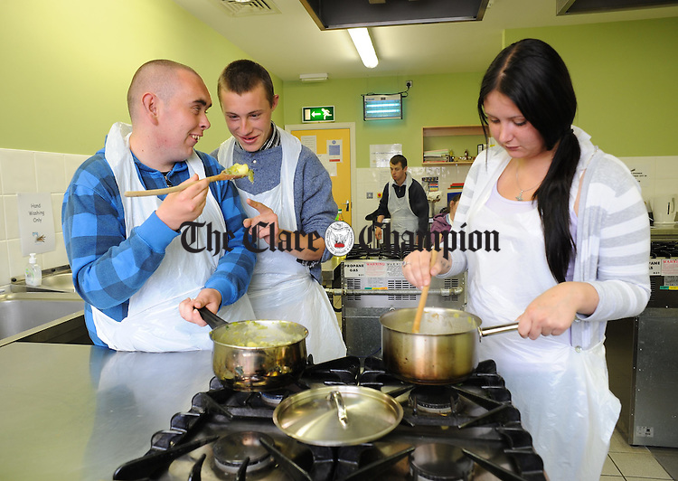 "Richard Mc Dermott, John Fitzgerald and Roisin Clune, members of Youthreach at The Brothers Of Charity, taking part in the HSE ""Cook It"" programme at the VEC centre at Clonroad, Ennis. Photograph by John Kelly."