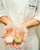 SINGAPORE, Ritz Carlton Hotel, mid section of chef holding moon cakes.