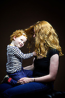 Regina Vereker, 31, stay at home mum from Uphall.<br /> <br /> 'I say red as my mum said Ginger is something you put in food. She was reddish brown, red also came from dad&rsquo;s side with two uncles and two cousins and two nieces, but it tends to be the girls.'  <br /> <br /> 'I got picked on a lot at school but pretty standard insults. My older sister dyed it and now her hair is breaking off. I let it be and am relieved now that I did so. People keep asking to have it dyed red they can&rsquo;t give them the exact colour.'<br /> <br /> 'Red hair makes you very quiet. You kept to yourself, last thing you want is ginger hair. I feel sad for my daughter as it might happen to her. Being noticed is the best and worst thing about it. You get compliments but I have had people walk away from me in the street.'  <br /> <br /> 'I used to live in London and you are definitely noticed more. Isla [daughter] gets really stared at so I am really protective of her. In Edinburgh, I feel more at home. In Scotland its easier to be ginger.'<br /> <br /> Isla, 2, from Uphall.<br /> <br /> 'I have lovely red curly hair.'