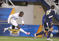 Darren Mattocks #11 of the University of Akron blasts a shot past Hamoody Saad #17 of the University of Michigan during the 2010 College Cup semi-final at Harder Stadium, on December 10 2010, in Santa Barbara, California. Akron won 2-1.