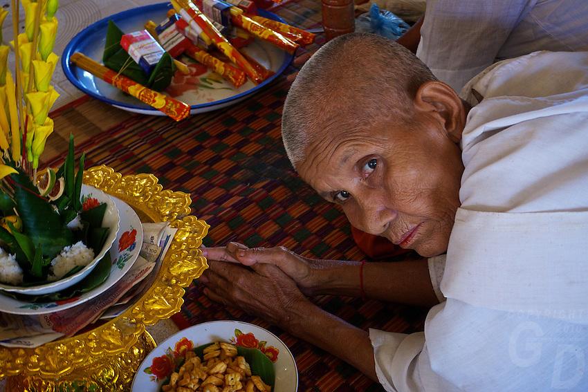A buddhist Nun at Wat Phnom Krom Pagoda and Monastery near the Tonle Sap, Cambodia