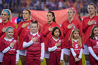 HOUSTON, TX - JANUARY 28: Julie Ertz #8, Abby Dahlkemper #7, Kelly O'Hara #5, Becky Sauerbrunn #4 and Samantha Mewis #3 of the United States during the national anthem during a game between Haiti and USWNT at BBVA Stadium on January 28, 2020 in Houston, Texas.