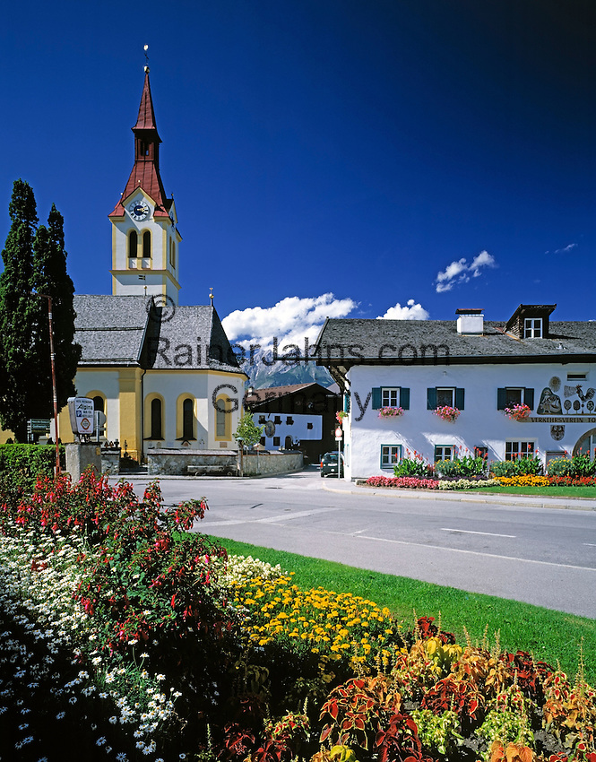 Austria, Tyrol, Igls near Innsbruck: parish church and tourist-office at village centre