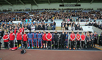 The Swansea bench stands while the French National anthem is played before the Barclays Premier League match between Swansea City and Bournemouth at the Liberty Stadium, Swansea on November 21 2015
