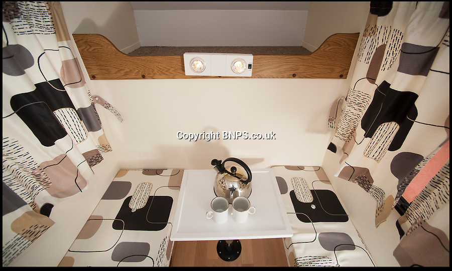 BNPS.co.uk (01202) 558833.Picture: Peter Willows..The cramper van is plumed with a sink and dual gas burner and comes with a dining table. The sink and hob fold away for additional seating...It might only have 4ft of living space but this mini mobile home comes with everything a camper would want including a cooker, a sink, a table and a bed. The 'cramper van' is thought to be the smallest camper van in the world. Creative mechanic Andy Saunders chopped 6ft off the front of a Bedford Bambi campervan and attached it to a Butlins pedal cart before fitting the bespoke interior.