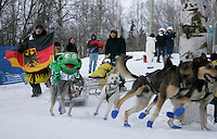 Benedikt Beisch runs next to his sled has he rounds a turn.in Anchorage on Saturday March 1st during the ceremonial start day of the 2008 Iidtarod Sled Dog Race.