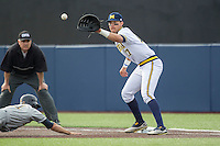Michigan Wolverines first baseman Drew Lugbauer (17) catches a pickoff attempt at first base against the Toledo Rockets on April 20, 2016 at Ray Fisher Stadium in Ann Arbor, Michigan. Michigan defeated Bowling Green 2-1. (Andrew Woolley/Four Seam Images)