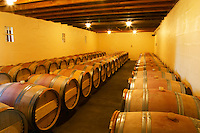 The barrel cellar for aging the wines in oak casks - Chateau La Grave Figeac, Saint Emilion, Bordeaux