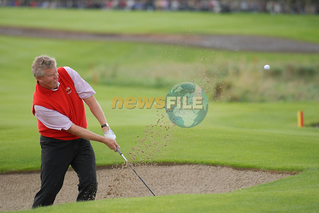 September 24th, 2006. European Ryder Cup team player Colin Montgomerie chips out of the bunker of the 17th green during the singles final session of the last day of the 2006 Ryder Cup at the K Club in Straffan,. County Kildare in the Republic of Ireland...Photo: Eoin Clarke/ Newsfile.<br />