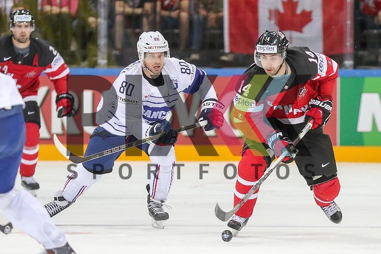 Canadas Eberle, Jordan (Nr.14) im Zweikampf mit Frankreichs da Costa, Teddy (Nr.80)  im Spiel IIHF WC15 France vs Canada.<br /> <br /> Foto &copy; P-I-X.org *** Foto ist honorarpflichtig! *** Auf Anfrage in hoeherer Qualitaet/Aufloesung. Belegexemplar erbeten. Veroeffentlichung ausschliesslich fuer journalistisch-publizistische Zwecke. For editorial use only.