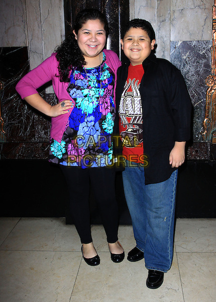 """RICO & RIANI RODRIGUEZ .Opening Night Of """"STOMP"""" held At The Pantages Theatre, Hollywood, California , USA, 26th January 2010..arrivals  full length brother sister family blue pink cardigan top hand on hip tunic black floral print leggings jeans jacket red t-shirt .CAP/ADM/KB.©Kevan Brooks/AdMedia/Capital Pictures."""