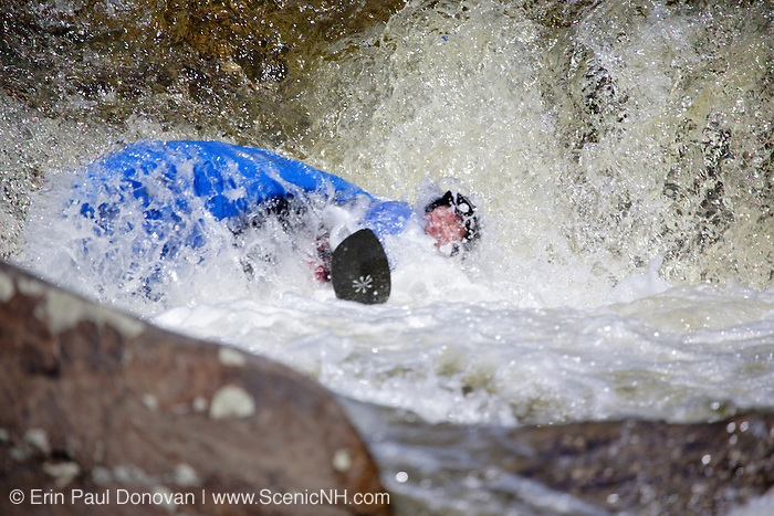 Kayaker going over Lower Falls along the Swift River during the spring months in the White Mountains, New Hampshire USA