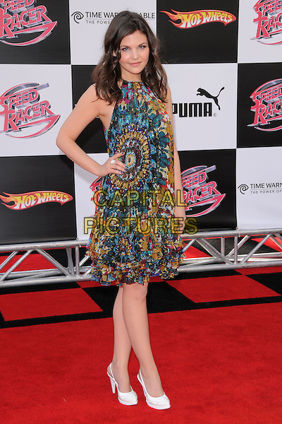 """GINNIFER GOODWIN .Attending The Warner Brothers Pictures World Premiere of """"Speed Racer"""" held at The Nokia Theatre in Los Angeles, California, USA, April 26th 2008.                                                                     full length floral patterned print dress hand on hip blue green white shoes ring.CAP/DVS.©Debbie VanStory/Capital Pictures"""