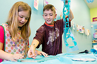 NWA Democrat-Gazette/CHARLIE KAIJO Haedyn Heckscher, 7 and Gabriel Treadwell, 8 create stencil art during a spring break art camp, Monday, March 19, 2018 at the Imagine Studios in Rogers. <br /><br />Melanie Hewing, owner and artist of Imagine Studios, worked as a literacy facilitator at Rogers High School for seven years and during that time discovered a talent and love for creating art through a side business painting murals in children's bedrooms. <br /><br />People began to ask if she would provide art classes for them as word spread. She has had her studio, Imagine Studios, now for seven years where she hosts classes and camps for both kids and adults.