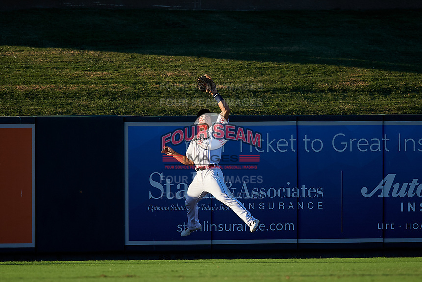 Lakeland Flying Tigers left fielder Brady Policelli (7) attempts to catch a fly ball during a Florida State League game against the Palm Beach Cardinals on May 22, 2019 at Publix Field at Joker Marchant Stadium in Lakeland, Florida.  Palm Beach defeated Lakeland 8-1.  (Mike Janes/Four Seam Images)