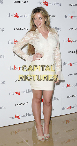 "Kierston Wareing.""The Big Wedding"" gala film screening, May Fair Hotel., London, England..May 23rd, 2013.full length white lace top shirt hand on hip cream skirt open toe shoes ruffle .CAP/CAN.©Can Nguyen/Capital Pictures."