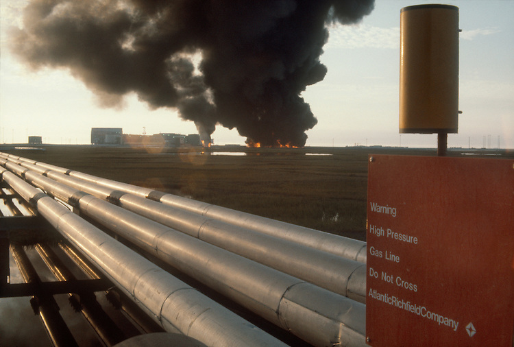 Alaska, oilfield pollution, Prudhoe Bay, North Slope, Excess pressure from gathering field oil pipeline causes a surge in the system forcing a bypass of the flow station (left) and burning of the crude oil.