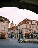 FRANCE, Arbois, man rides through Arbois on his motorcycle, Jura Wine Region