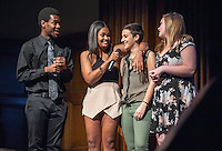 Emcees Edward Jackson '16 and Marielle Peña Rosario '16 talk with Grace Centauro '16 and  Linneen Warren '16 before they perform. Occidental College students perform at the annual Apollo Night talent show, hosted by the Black Student Alliance, in Thorne Hall, Friday, Feb. 21, 2014. 15 acts performed a variety of music and dance. (Photo by Marc Campos, Occidental College Photographer)