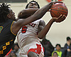 Jayson Robinson #5 of Amityville, right, draws a shooting foul on Rashaun Molloy #10 of Wyandanch during a Suffolk County League VI varsity boys basketball game at Amityville High School on Tuesday, Jan. 2, 2018. Amityville won by a score of 95-50.