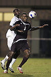 05 October 2007: Boston College's Sherron Manswell (8) shields Duke's Christian Ibeagha (left) away from the ball. Boston College defeated Duke University at Koskinen Stadium in Durham, North Carolina in an NCAA Men's soccer game.