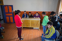 Tibetan teachers lecture blind and visually impaired Tibetan students during a disciplinary session at the School for the Blind in Tibet, in the capital city of Lhasa, September 2016.