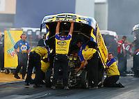 Jul. 26, 2013; Sonoma, CA, USA: NHRA crew members for funny car driver Matt Hagan during qualifying for the Sonoma Nationals at Sonoma Raceway. Mandatory Credit: Mark J. Rebilas-