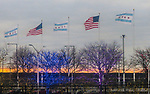 Transportation images; Airport, American and Chicago flags outside Chicago's O'Hare Airport, 2017. (DePaul University/Jamie Moncrief)