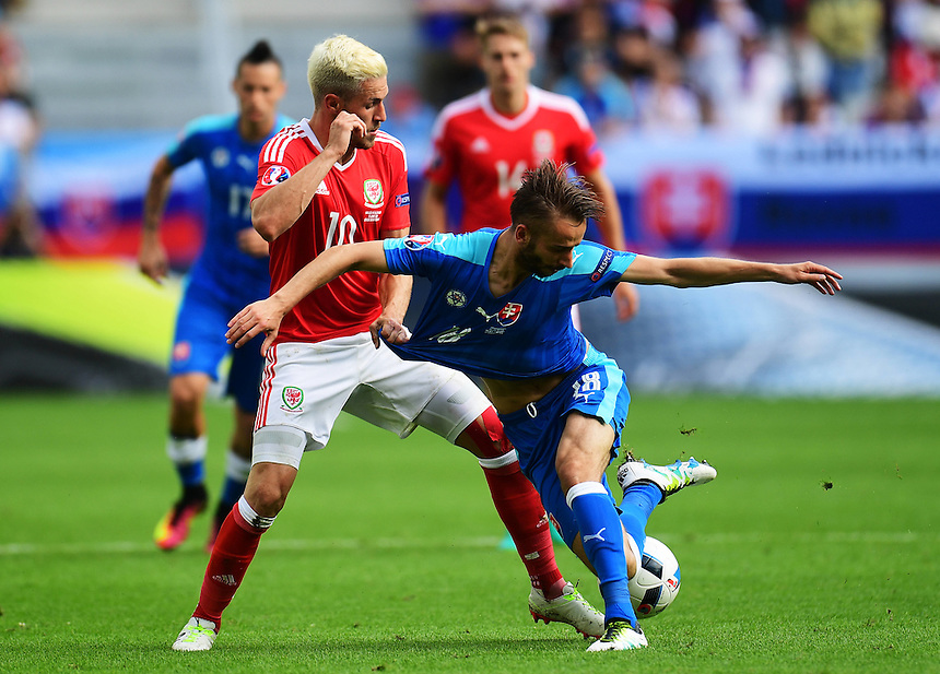Wales's Aaron Ramsey vies for possession with Slovakia's Dusan Svento<br /> <br /> Photographer Kevin Barnes/CameraSport<br /> <br /> International Football - 2016 UEFA European Championship - Group B - Wales v Slovakia - Saturday 11th June 2016 - Nouveau Stade de Bordeaux, Bordeaux<br /> <br /> World Copyright &copy; 2016 CameraSport. All rights reserved. 43 Linden Ave. Countesthorpe. Leicester. England. LE8 5PG - Tel: +44 (0) 116 277 4147 - admin@camerasport.com - www.camerasport.com