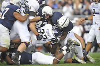 06 October 2012:  Penn State  LB Mike Hull (43) and Gerald Hodges (6) tackles Northwestern RB Mike Trumpy (32). The Penn State Nittany Lions defeated the Northwestern Wildcats 39-28 at Beaver Stadium in State College, PA.
