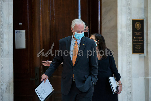 United States Senator Ron Johnson (Republican of Wisconsin) departs following a U.S. Senate Committee on Homeland Security and Governmental Affairs meeting in the Senate Russell Office Building in Washington D.C., U.S., on Wednesday, May 20, 2020, to consider a motion to issue a subpoena to Blue Star Strategies.  Credit: Stefani Reynolds / CNP/AdMedia
