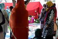 Roma, 17 Luglio 2015<br /> La comunità musulmana di Cinecittà affolla i giardini di Piazza dei Consoli , per la preghiera di Eid al-Fitr che segna la fine del mese di digiuno del Ramadan.<br /> Lo spazio riservato alla preghiera delle donne.<br /> Rome, July 17, 2015. <br /> Muslim immigrants crowd the garden of  Piazza dei Consoli, in  multi-ethnic quarter, for the Eid al-Fitr prayer marks the end of the holy month of Ramadan.