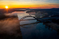 Steam gently rises off Lake Austin under the 360 Pennybacker Bridge to form steam fog and clouds over the limestone cliffs that line the lake. This happens when the outside air is colder than the lake water. This is my favorite season to capture the 360 bridge.
