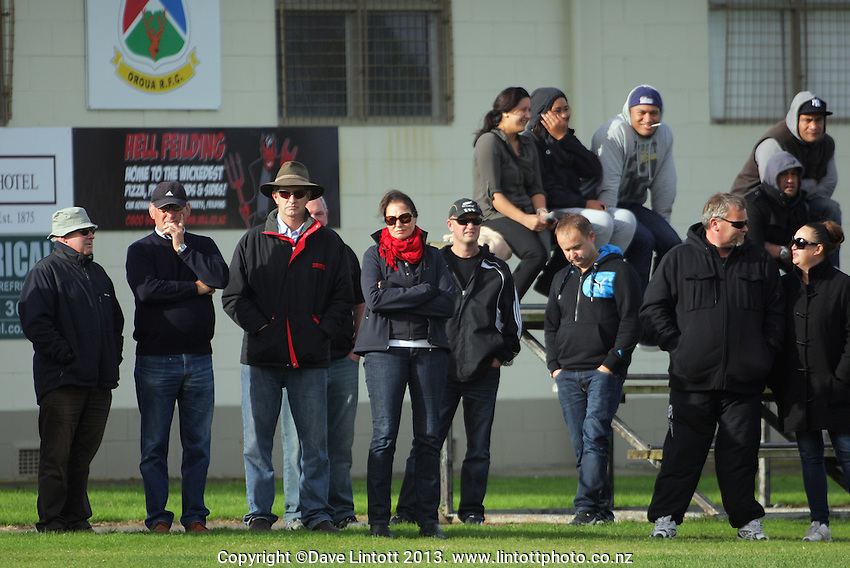Fans watch from the sideline during the Manawatu Club Rugby match between FOB-Oroua and Kia Toa at Johnson Park, Feilding, New Zealand on Saturday, 20 April 2013. Photo: Dave Lintott / lintottphoto.co.nz