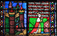 Stained glass window of Empress Eugenie at prayer wearing her imperial robes and crown, 1854, by Alfred Gerente, 1821-68, in the apsidal chapel of St Theodosie, at the Basilique Cathedrale Notre-Dame d'Amiens or Cathedral Basilica of Our Lady of Amiens, built 1220-70 in Gothic style, Amiens, Picardy, France. Alfred Gerente designed the chapel and included portraits of Napoleon III and Eugenie to commemorate their visit to the chapel in 1853, when Eugenie became the chapel's patron. Amiens Cathedral was listed as a UNESCO World Heritage Site in 1981. Picture by Manuel Cohen