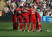 Watford players huddle before kick off during the Premier League match between Swansea City and Watford at The Liberty Stadium, Swansea, Wales, UK. Saturday 23 September 2017