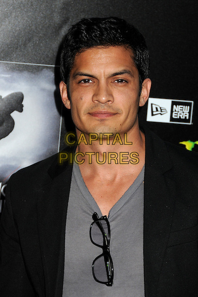 "Nicholas Gonzalez.""Waiting For Lightning"" Los Angeles Screening held at The Cinerama Dome, Hollywood, California, USA..April 10th, 2012.headshot portrait grey gray top black jacket glasses.CAP/ADM/BP.©Byron Purvis/AdMedia/Capital Pictures."