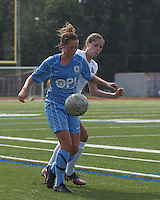 Seacoast United Mariners midfielder Taylor Littlefield (5) attempts to control the ball as Boston Aztec defender Jessica Morrow (26) presures. In a Women's Premier Soccer League (WPSL) match, Boston Aztec (white) defeated Seacoast United Mariners (blue), 2-1, at North Reading High School Stadium on Arthur J. Kenney Athletic Field on on June 23, 2013. Due to injuries through the season, Seacoast United Mariners could only field 10 players.