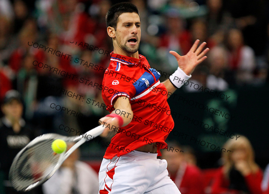 Novak Djokovic of Serbia returns the ball to Gael Monfils of France during their Davis Cup finals tennis match in Belgrade, Serbia, Sunday, Dec. 5, 2010. (credit & photo: Srdjan Stevanovic/Starsportphoto.com)