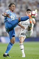 Real Madrid's Marco Asensio (r) and Getafe CF's Damian Suarez during La Liga match. August 19,2018.  *** Local Caption *** &copy; pixathlon<br /> Contact: +49-40-22 63 02 60 , info@pixathlon.de