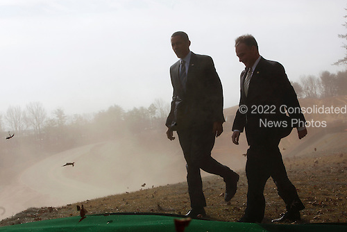 Springfield, VA - February 11, 2009 -- United States President Barack Obama walks with Virginia Governor Tim Kaine, after looking at a mad of  the Construction site of Fairfax County Parkway connector that ther are visiting,  Springfield , VA, Tuesday, February 11, 2009..Credit: Aude Guerrucci - Pool via CNP