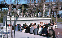 San Francisco, Ferry Park. People sunning on cool January day. Plaza design by Lawrence Halprin & Assoc. (Photo '83)