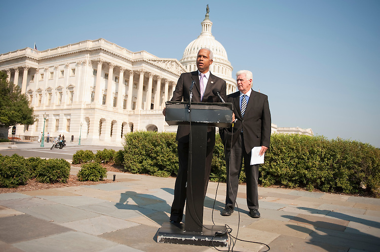 "UNITED STATES - SEPTEMBER 14:  Reps. Jim Moran, D-Va., right, and Hank Johnson, D-Ga., conduct a news conference at the House Triangle to introduce the ""Full Faith and Credit Act of 2011,"" which would eliminate the federal debt ceiling, and ensure that the U.S. would not default on it's financial obligations. (Photo By Tom Williams/Roll Call)"