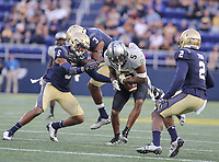 Annapolis, MD - October 21, 2017: UCF Knights wide receiver Dredrick Snelson (5) breaks a tackle during the game between UCF and Navy at  Navy-Marine Corps Memorial Stadium in Annapolis, MD.   (Photo by Elliott Brown/Media Images International)